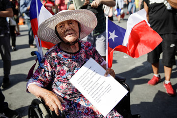 People take part in a protest against Chile's government in Santiago
