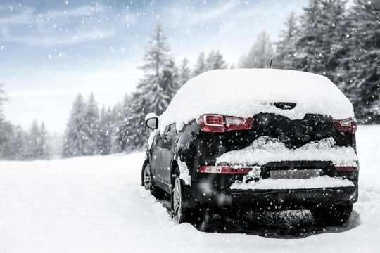 Black car of snow and free space for your decoration.
