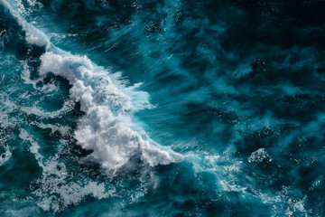 Aerial view to waves in ocean Splashing Waves. Blue clean wavy sea water. Bali, Indonesia.