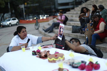A relative of missing person reacts during a demonstration to demand justice for the victims of enforced disappearances at the Angel de la Independencia monument in Mexico City