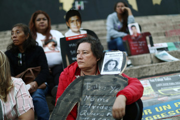 A relative of missing person is pictured in a demonstration to demand justice for the Victims of Enforced Disappearances at Angel de la Independencia monument in Mexico City
