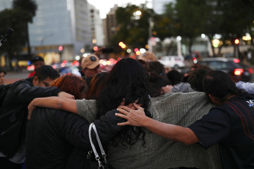 Relatives of missing persons hug during a demonstration to demand justice for the victims of enforced disappearances at the Angel de la Independencia monument in Mexico City