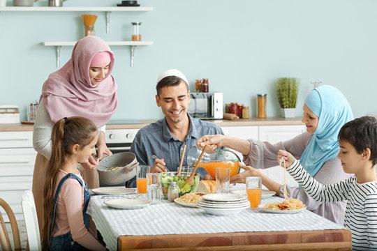 Muslim family having dinner at home