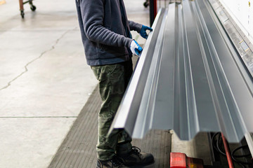 Corrugated roofing metal sheets produced in a factory