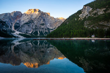 Beautiful reflection of Seekofel mountain in Lake Braies at sunrise, Italy