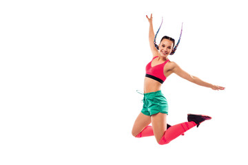 Cheerful young woman jumping and dancing zumba on white background. Copy space.