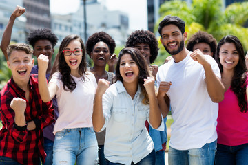 Group of successful cheering latin and caucasian and hispanic and african american young adults Wall mural