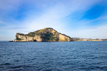 Campi Flegrei, Naples, Campania, Italy: the lighthouse of Cape Miseno seen from the sea. Capo Miseno is the headland on the Bay of Pozzuoli and the Gulf of Naples