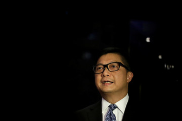Hong Kong's Commissioner of Police Chris Ping-keung Tang speaks at a news conference at the Regent hotel in Beijing