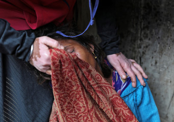 A sister of a 23-year-old rape victim, who died in a New Delhi hospital on Friday, after she was set on fire by a gang of men, which included her alleged rapists, is consoled as she mourns her sisters' death outside a house in Unnao
