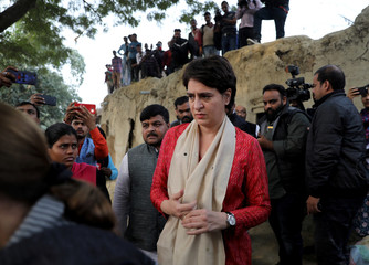 Priyanka Gandhi Vadra arrives to meet the relatives of a 23-year-old rape victim, who died in a New Delhi hospital on Friday after she was set on fire by a gang of men, which included her alleged rapists, in Unnao
