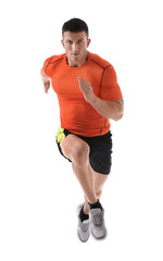 Athletic young man running on white background