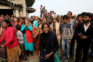 Relatives of the accused react as they demand a Central Bureau of Investigation probe into the rape of a 23-year-old victim, who died in a New Delhi hospital on Friday, after she was set on fire by a gang of men, which included her alleged rapists, i
