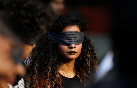 A protestor wearing a blindfold takes part in a protest in solidarity with rape victims and to oppose violence against women in India, in New Delhi