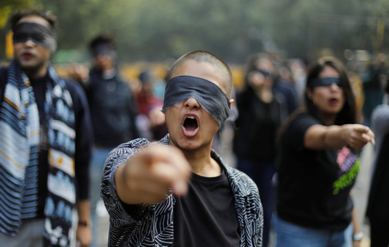 Protestors wearing blindfolds take part in a protest in solidarity with rape victims and to oppose violence against women in India, in New Delhi