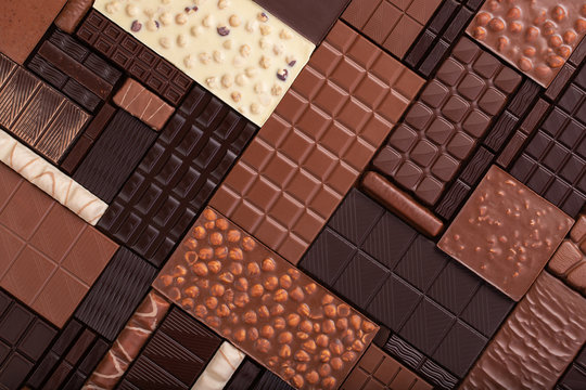 varied chocolate background. milk and dark cocoa bar, top view.
