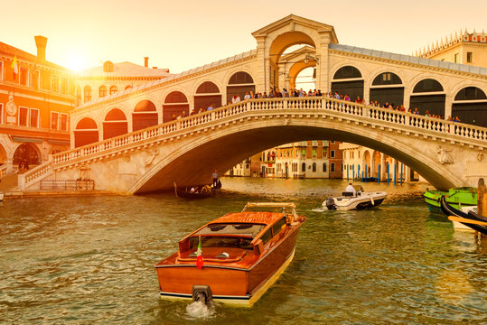Rialto Bridge over the Grand Canal at sunset, Venice, Italy. It is a famous landmark of Venice.