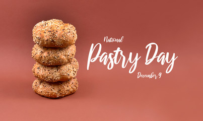 National Pastry Day. Pile of bread stock images. Croissant and wholemeal bun isolated on a brown background. Butter croissants and buns stock images. Pastry Day Poster, December 9. Important day