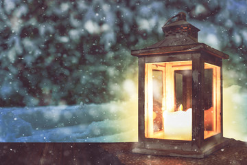 Christmas lantern on wooden table and landscape of winter night. Space for text.