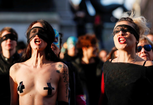 "Women rights activists wear blindfolds and sing a song ""the rapist is you"", that became famous in Chile, in front of the Palace of Justice in Rome"