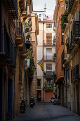 Typical street of Valencia old town, Spain
