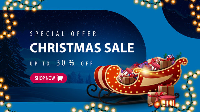 Special offer, Christmas sale, up to 30% off, blue discount banner with tinted winter landscape, garland, pink button and Santa Sleigh with presents