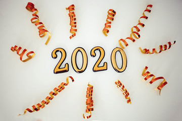 Gold color 2020 numbers . Symbol of the new year and Christmas.