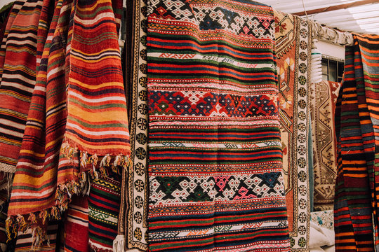 Sell-out. Market in Bodrum. Authentic traditional turkish rugs. Patterns on the carpets. Ethno style. Comfort. Home decoration. Embroidery. Carpet for the floor.Turkish carpet.