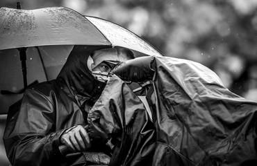 Cameramen in rain