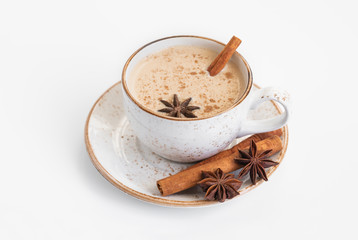 Garden Poster Tea Indian Masala chai tea. Traditional Indian hot drink with milk and spices on white background closeup.
