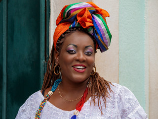 Happy Brazilian Woman of African Descent Dressed in Traditional Baiana Costumes in Salvador da Bahia, Brazil