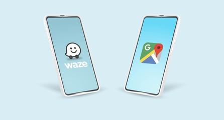 Android phone with popular navigation application icons: Waze and Google Maps
