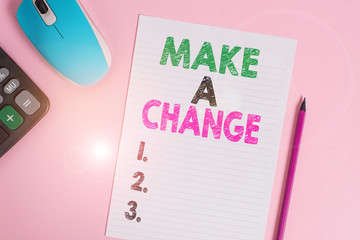 Text sign showing Make A Change. Business photo text Create a Difference Alteration Have an Effect Metamorphose Electronic calculator wire mouse striped sheet pencil colored background