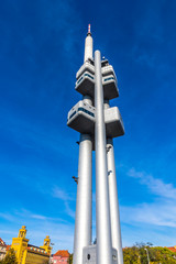 Prague, Czech Republic - October 26, 2019: Zizkov Television Tower (216 metres) in Prague with Tower Babies sculpture on it by David Cerny