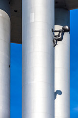 Prague, Czech Republic - October 26, 2019: Details of Tower Babies sculpture by David Cerny at the Prague Zizkov Television Tower in Prague (built in 1985-1992, height 216 metres)