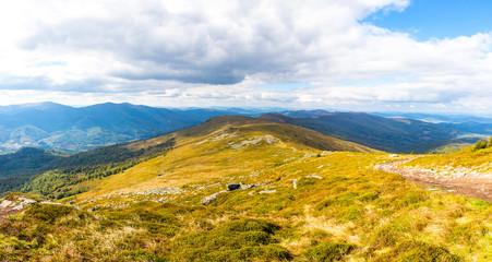 Picturesque panoramic landscape of Carpathian mountains in early autumn. View from mount Pikui (1405m), Carpathians, Ukraine
