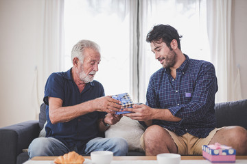 Father's day concept - Son hold a gift box to give to the father on important occasions.