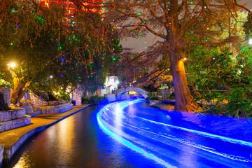 San Antonio River Walk and stone bridge over San Antonio River near Alamo in downtown San Antonio, Texas, TX, USA.