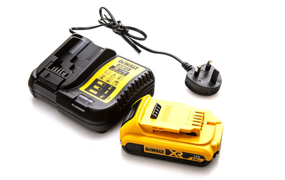 DeWalt DCB113 cordless power tool battery charger and battery on a white background