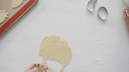 Wall Mural - Step by step. Flat lay. Cutting sugar cookie dough with Easter shaped cookie cutters.