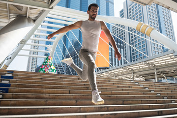 Sporty man run and jump in city
