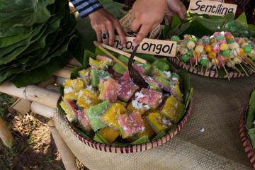 Ongol-ongol: Javanese traditional kue made from dried palm sago flour, water, Javanese sugar, pandan leaves, etc.