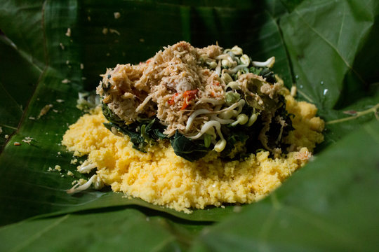 Indonesia or Javanese traditional food from corn, with gudangan (vegetables and coconut sambal)