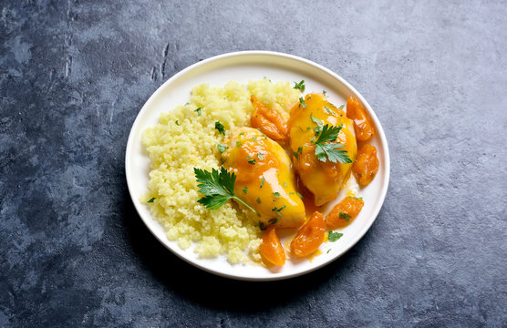 Chicken breasts in apricot sauce and couscous