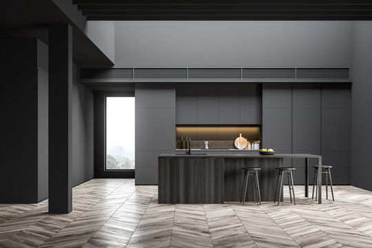 Spacious loft gray kitchen with bar and stools