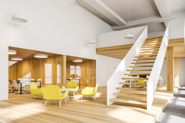 Yellow armchairs waiting room in open space office