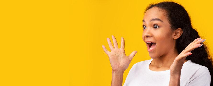Excited african american teen surprised by mega sale