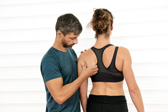 Osteopath doing a shoulder blade evaluation