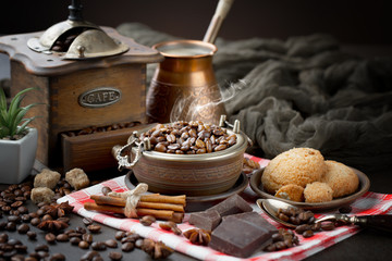 Wall Murals Cafe Coffee grains on a table with accessories for coffee