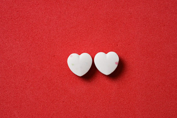 Two heart shaped candies